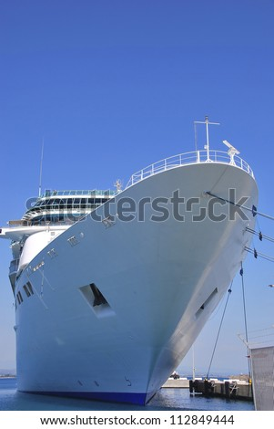 Cruise ship moored in the harbor. Luxury travel and holidays