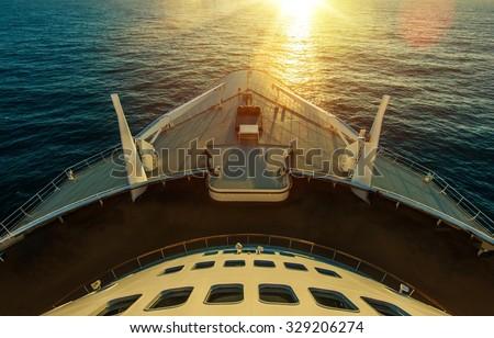 Cruise Ship Ocean Crossing. Sunset Scenery. Large Cruise Vessel. Ocean Liner. Marine Transportation.
