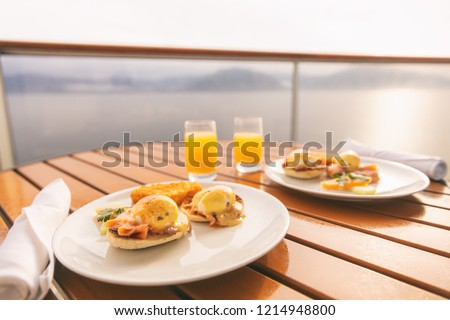 Cruise ship vacation food breakfast on suite balcony table in room service. Caribbean travel getaway, winter escape or honeymoon cruise in Europe or Santorini.