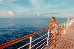 Cruise ship vacation travel luxury Caribbean holiday tourist woman watching sunset from balcony deck. Happy Asian woman enjoying holidays.