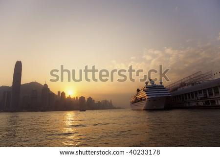 Cruise Ship with Skyline of Hong Kong at Sunset