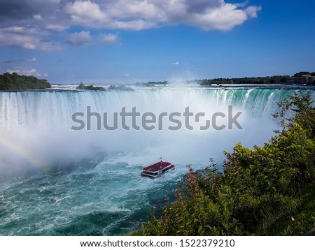 Cruise ship with tourists aboard looking at the Horseshoe Falls. Horseshoe Falls,  Niagara Falls.
