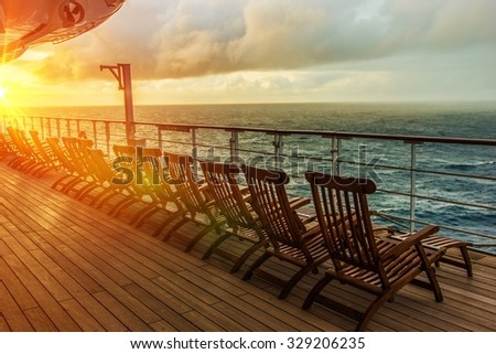 Cruise Ship Wooden Deck Chairs. Cruise Ship Main Deck at Sunset. #329206235