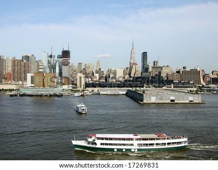 Cruise ships and ferries sailing around Manhattan, New York City.