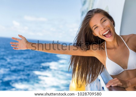 Cruise vacation on cruise travel holiday in caribbean beach. Asian girl with open arm in freedom happy excited. Tourist woman screaming of joy. Happy traveler having fun on summer vacations. #1028709580