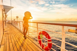 Cruise vacation woman watching sunset on deck - Caribbean tropical holiday travel lifestyle.