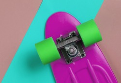 Cruiser board on colored paper background. Summer fun. Studio shot. Top view