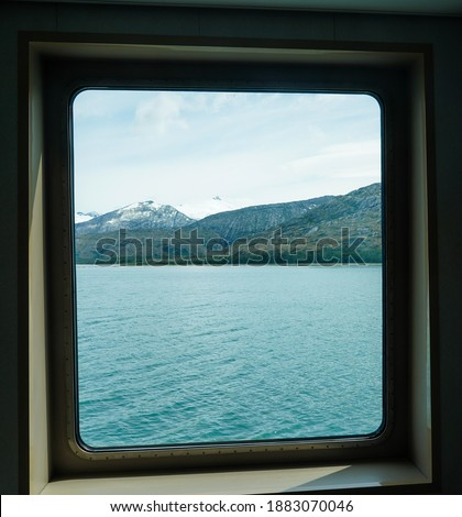 Cruising Beagle Channel in Chilean Patagonia. It is a strait in Tierra del Fuego Archipelago on the extreme southern tip of South America  stock photo