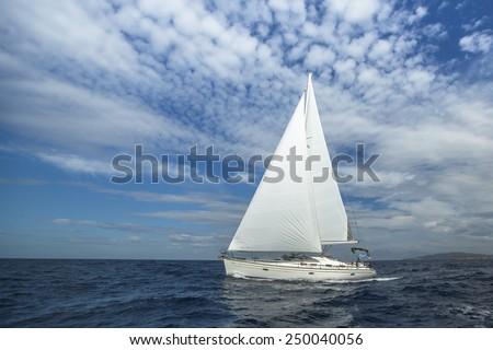 Cruising on a sailing boat. Boat in sailing regatta. Luxury yachts.