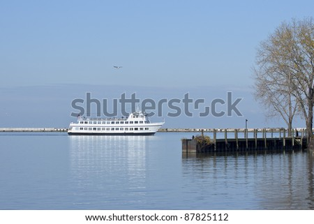 Cruising the Harbor:  A tourist excursion boat cruises inside the breakwater separating the western basin of the harbor at Cleveland, Ohio from the open waters of Lake Erie