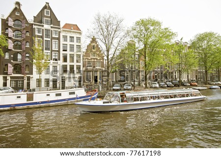 Cruising through Amsterdam canals in the Netherlands