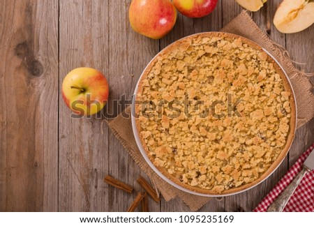 Crumble apple cake on white dish.