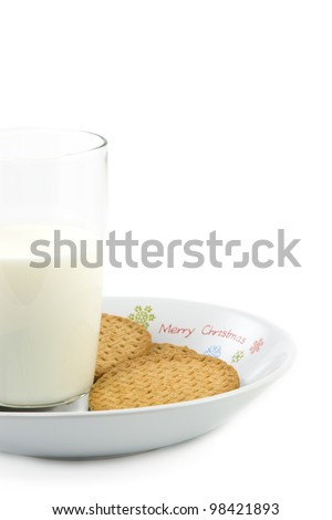 Crumbly cookies on dish with glass of milk, on white background