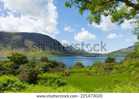 Crummock Water Lake District North West England UK between Buttermere and Loweswater on summer day with blue sky and white clouds