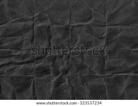 Crumpled black paper. Grunge paper texture. Black abstract background