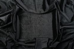 Crumpled black velvet texture background