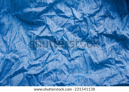 crumpled blue crepe paper texture as background
