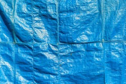 Crumpled blue textile surface