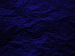 Crumpled dark blue paper texture background