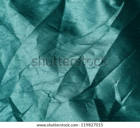 crumpled green fabric background