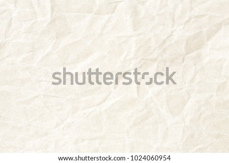 Crumpled pale yellow paper texture