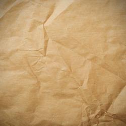 Crumpled paper background vignette