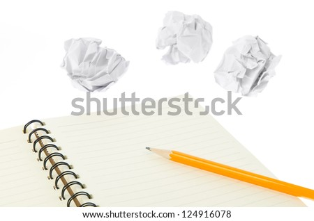 Crumpled paper ball and notepad - stock photo