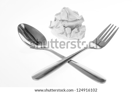 Crumpled paper ball and tableware