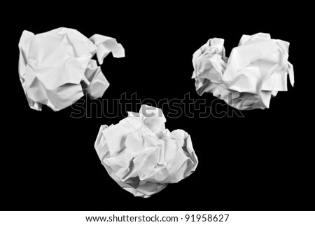 Crumpled paper ball isolated on a black background
