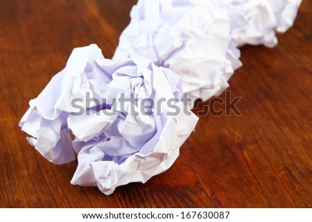 Crumpled paper balls on wooden background
