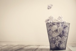 Crumpled paper in the trash can