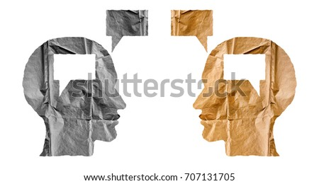 Crumpled paper shaped as a human heads and talk balloons on white background. Conversation, dialogue and opinion concept. #707131705