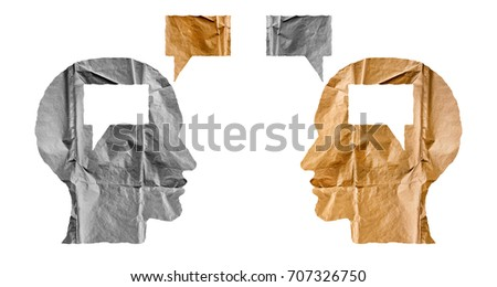 Crumpled paper shaped as a human heads and talk balloons on white background. Conversation, dialogue and opinion concept. Two heads. #707326750