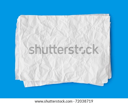 Crumpled paper stack isolated on blue background