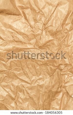 Crumpled paper texture background. Craft paper sheet, brown color. Texture of crumpled paper.