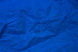 Crumpled paper texture, blue color