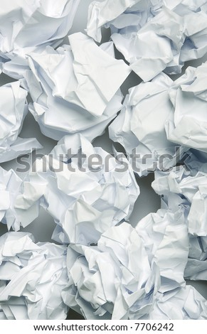 Crumpled paper wads after brainstorming