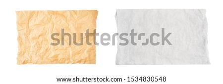 Crumpled piece of brown and white parchment or baking paper isolated on white background. Top view. Copy space for text. Design element.