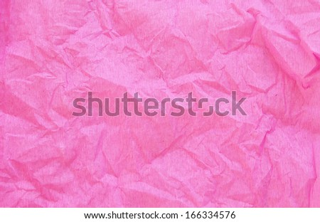 crumpled pink crepe paper texture as background