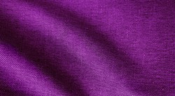 crumpled purple or violet fabric texture, wavy wrinkled cloth pattern. close up soft linen fabric background.