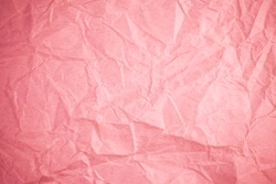 Crumpled recycle pink paper background.
