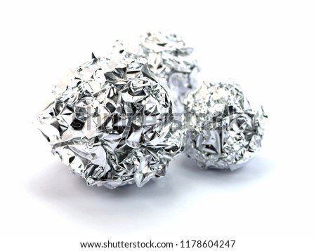Crumpled silver paper in ball shape #1178604247