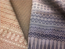 crumpled thai silk fabric textured background. artistic variety shade tone colors ornaments patterns of traditional cultural thai textiles with decorative ornaments crafts by local people