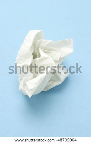Crumpled two ply tissue paper on blue seamless background
