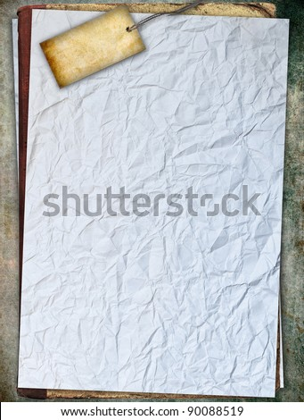 Crumpled white paper with tag, background