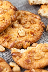 crunchy cookies with roasted peanuts, on the surface of a round fresh cookie caramel with peanuts, delicious round cookies from different ingredients