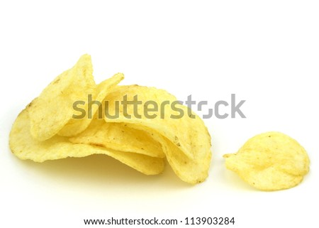 Crunchy golden potato chips isolated on white background with copy space.