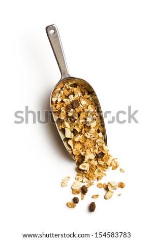 crunchy muesli in scoop on white background