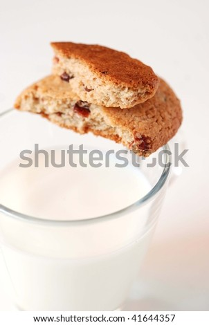 Crunchy oatmeal cookies with cranberries and a cup of milk