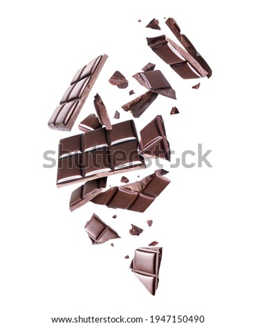 Crushed bar of dark chocolate in the air on a white background Foto stock ©